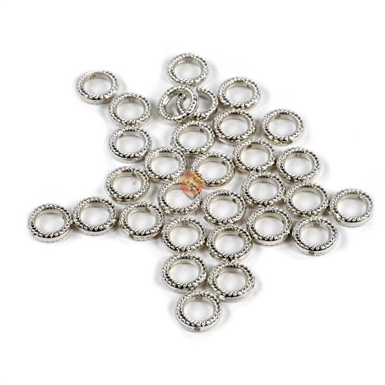Plastični členi kovinski izgled krog 10mm 30 kosov