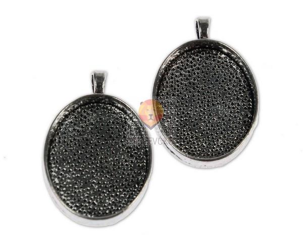 Ovalni medaljon 23 x 30 mm, 2 kos