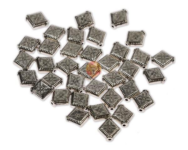 Perle kovinske - rombi z vzorčkom, 36 kos